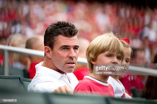 Former St Louis Cardinals player Jim Edmonds sits in the stands with his family during the game between the Pittsburgh Pirates and the St Louis...