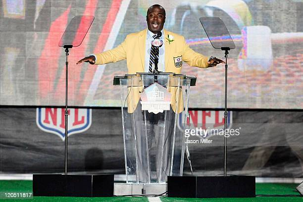Former St Louis Rams running back Marshal Faulk talks to the fans after uveiling his bust at the Enshrinement Ceremony for the Pro Football Hall of...