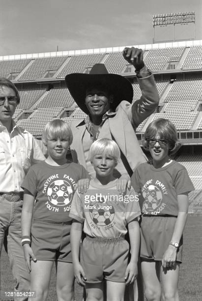 Former standout player Pele poses with three young soccer players Andy Junge, Dan Junge and Jeff Nesheim from Cheyenne, Wyoming during a soccer game...