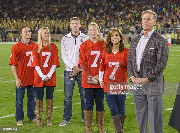 Former Stanford quarterback John Elway and family take part in the retirement of Elway's Stanford football jersey number 7 during halftime of a PAC12...