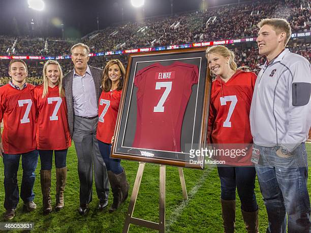Former Stanford quarterback John Elway and his family take part in the retirement of Elway's Stanford jersey number 7 during halftime of a PAC12 NCAA...