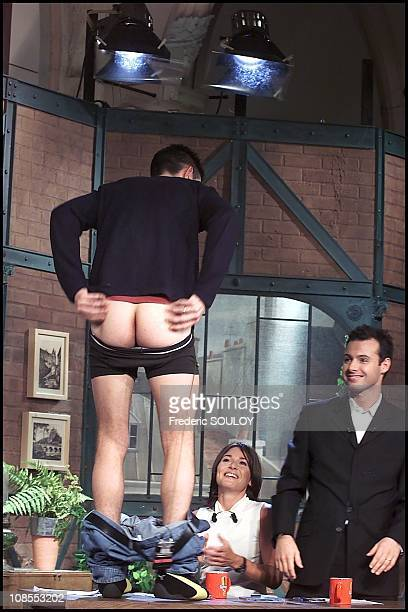 Former Star Academy student Jean Pascal bares his butt live on the set of The Big Issue on Comedie cable channel in France on January 21 2002