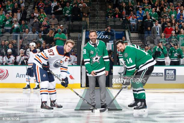 Former Star Vernon Fiddler drops a ceremonial first puck between Connor McDavid of the Edmonton Oilers and Jamie Benn of the Dallas Stars at the...