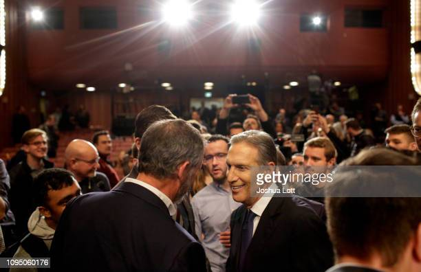 Former Starbucks CEO Howard Schultz greets attendees after speaking at Purdue University's Fowler Hall on February 7 2019 in West Lafayette Indiana...