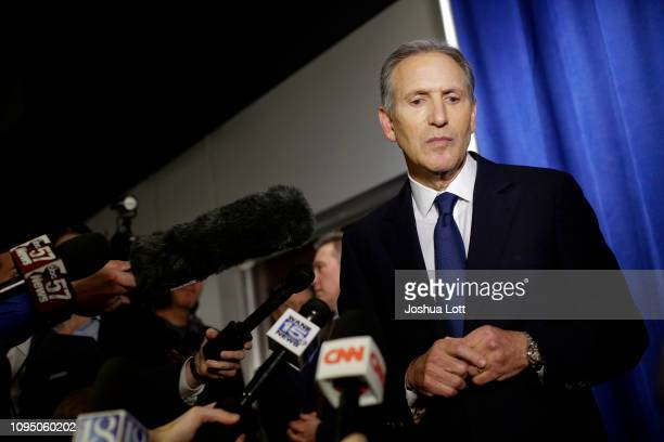 Former Starbucks CEO Howard Schultz pauses as he talks to reporters at a news conference after speaking at Purdue University's Fowler Hall on...