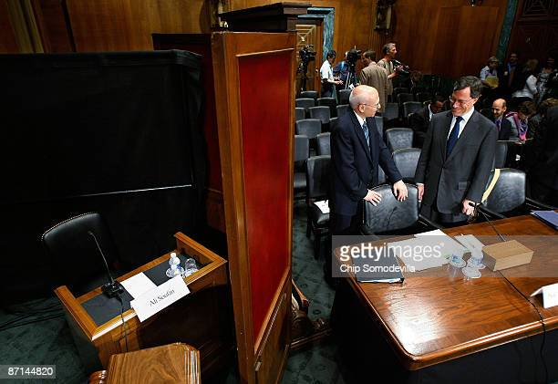 Former State Department lawyer Philip Zelikow talks with Georgetown University Professor of Law David Luban as they stand next to a desk set aside...