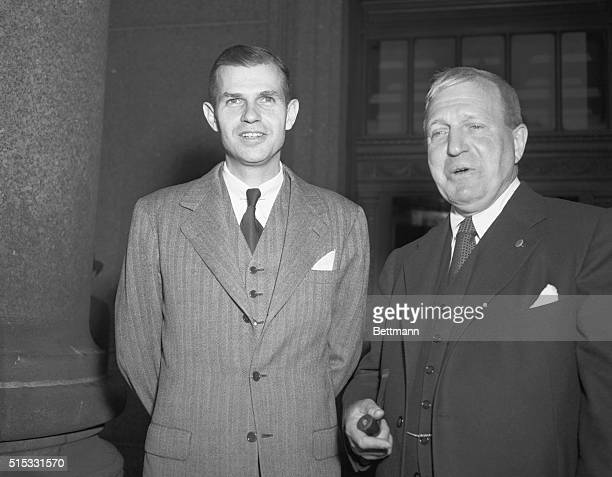 Former State Department official Alger Hiss and his lawyer Lloyd P Stryker enter New York City's Federal Court Building May 31 as Hiss' perjury trial...