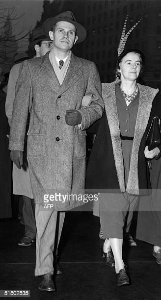 Former State Department official Alger Hiss and his wife leave the New York Federal Court 21 January 1950 after hearing sentence of five years...