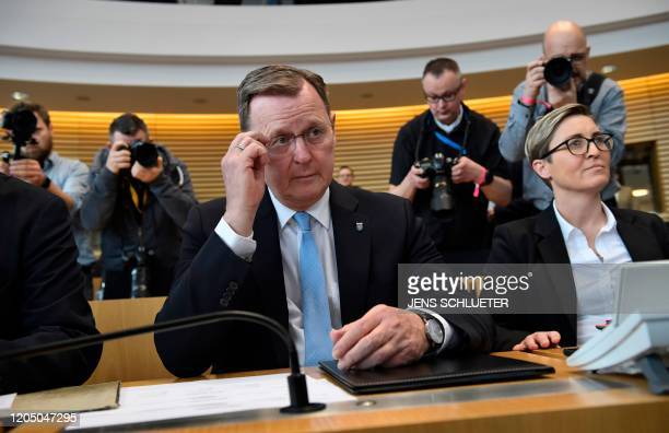Former state premier Bodo Ramelow of the far left Die Linke party sits next to Thuringia's Die Linke leader Susanne HennigWellsow at the Thuringian...