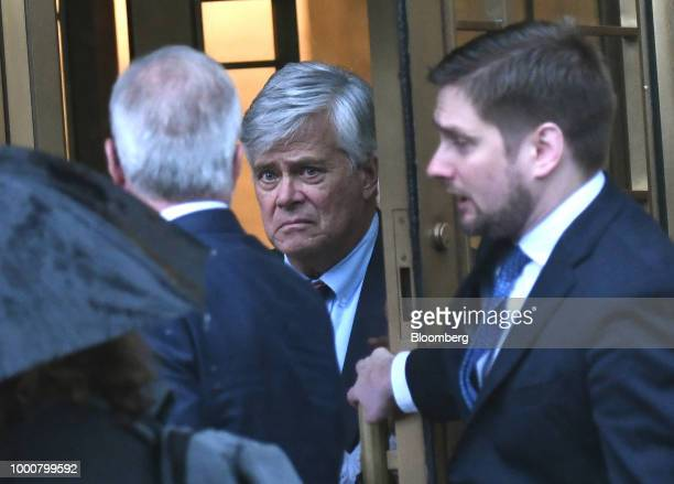 Former State Senate Majority Leader Dean Skelos center exits federal court in New York US on Tuesday July 17 2018 Skelos was found guilty of bribery...