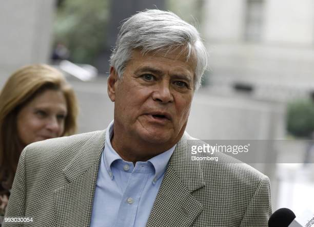 Former State Senate Majority Leader Dean Skelos speaks to a member of the media while exiting federal court in New York US on Friday July 6 2018...