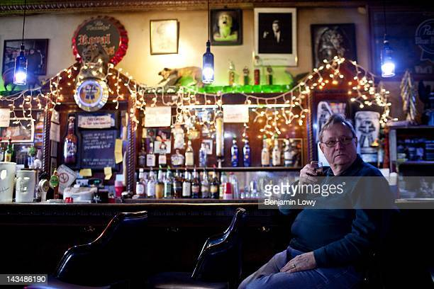 A former steel industry worker drinks in a bar a small bar on February 7 2012 in Youngstown Ohio