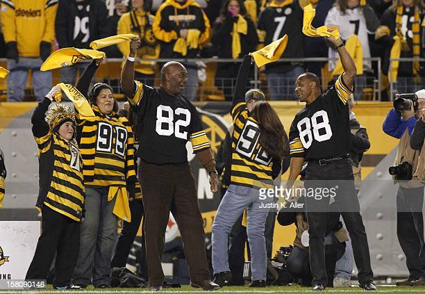Former Steelers Lynn Swann and John Stallworth wave their terrible towels before the game against the Baltimore Ravens on November 18 2012 at Heinz...