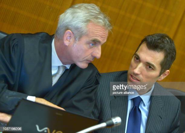 Former stock market guru Markus Frick talks with his lawyer Daniel Krause during a news conference at the regional court in Frankfurt Main Germany 24...