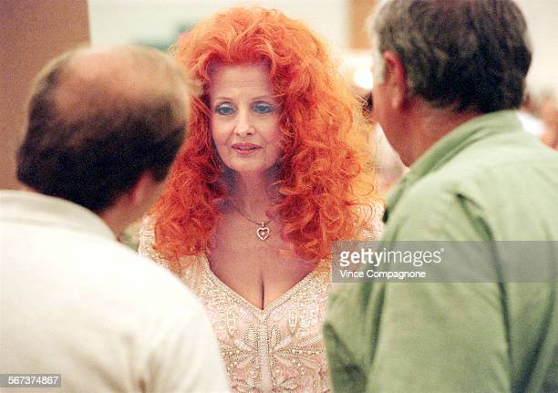 Former stripper Tempest Storm chats with fans during a glamour fest held in Burbank at which former Playboy Playmates and othert favorite pinups were...