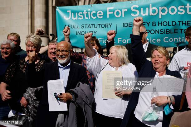 Former subpostmasters celebrate outside the Royal Courts of Justice in London, on April 23 following a court ruling clearing subpostmasters of...