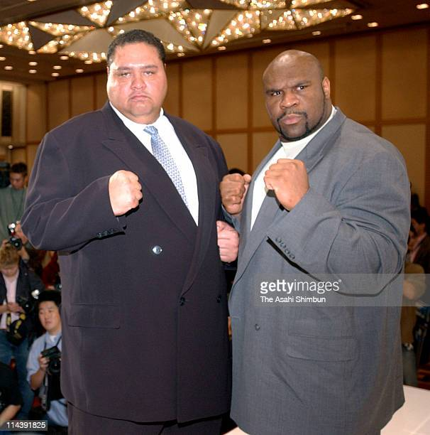 Former sumo grand champion Akebono and Bob Sapp pose for photographs during the press conference at the Imperial Hotel on November 6 2003 in Tokyo...