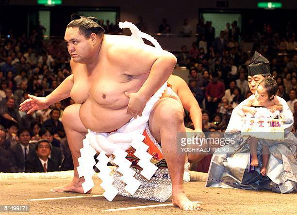 Former sumo grand champion or Yokozuna Akebono performs his last ring entrance before the hair cutting ceremony for the official retirement from...