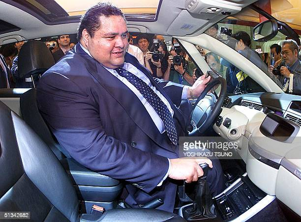 Former sumo grandchampion Akebono sits in the driver's seat of French automaker Renault's Avantime new concept coupe after he received the key as...