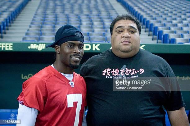 Former sumo wrestler Musashimaru greets Atlanta Falcons quarterback Michael Vick at Tokyo Dome August 4, 2005. The Atlanta Falcons will play the...