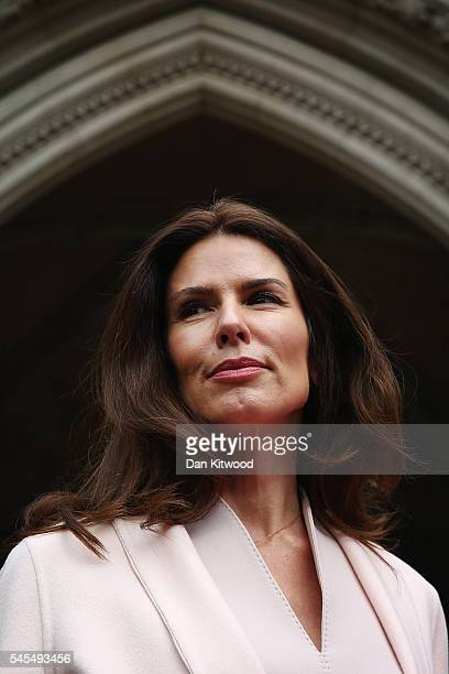 Former supermodel Christina Estrada poses for the cameras in front of the High Courtat Royal Courts of Justice Strand on July 8 2016 in London...