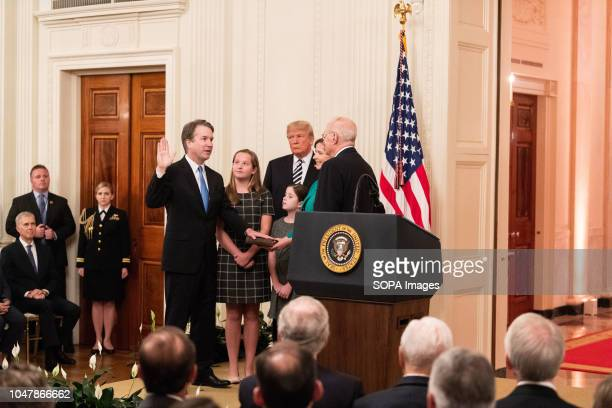 Former Supreme Justice Anthony Kennedy swearing in Brett Kavanaugh as an Associate Justice of the Supreme Court in the East Room of the White House