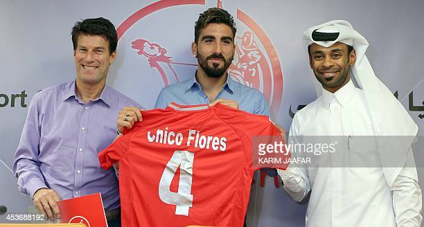 Former Swansea City's Spanish defender Chico Flores poses with Qatar's Lekhwiya new Danish head coach Michael Laudrup and Qatari Lekhwiya team...
