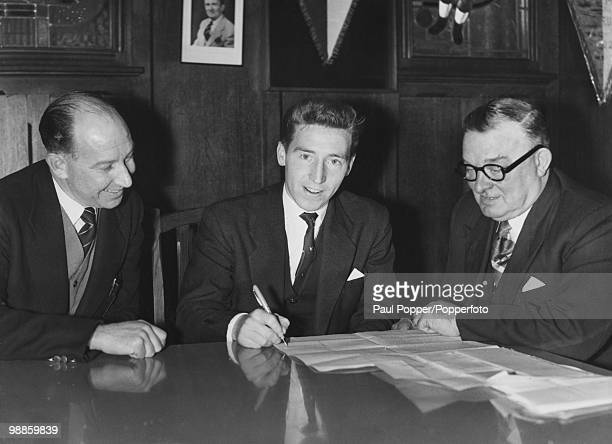 Former Swansea Town leftwinger Cliff Jones signs to Tottenham Hotspur for a record transfer fee of 35 thousand pounds 15th February 1958 Looking on...