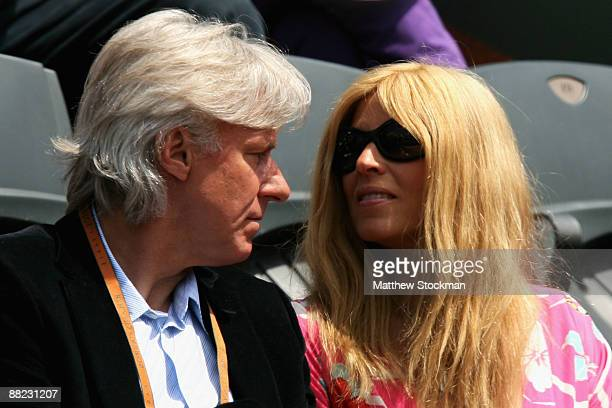 Former Swedish tennis player Bjorn Borg and his wife Patricia Ostfeldt watch the action during the Men's Singles Semi Final match between Robin...