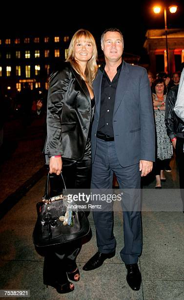 Former swimming champion Franziska van Almsick and her boyfriend Juergen B Harder make their way to the Hugo Boss fashion show after party at the...
