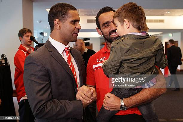 Former Sydney Swans AFL player Michael O'Loughlin is seen with his son James O'Loughlin and former team mate Adam Goodes prior to speaking to media...