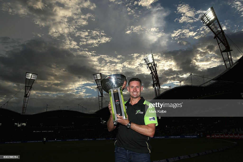 Former Sydney Thunder captain Michael Hussey poses with the 2015/16 Big Bash trophy the Big Bash League match between the Sydney Thunder and the Sydney Sixers at Spotless Stadium on December 20, 2016 in Sydney, Australia.