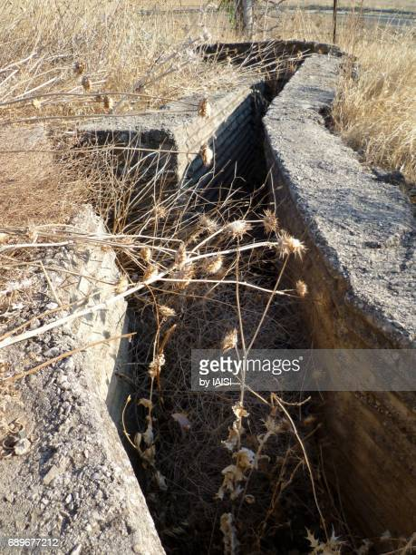 former syrian position and trenches on the golan heights - trench warfare stock photos and pictures
