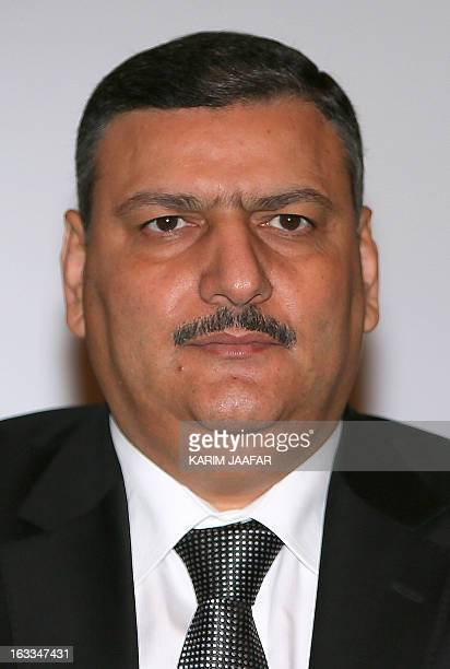 Former Syrian premier Riad Hijab chairs the first official meeting of the Free National Gathering's general assembly in Doha on March 8 2013 AFP...