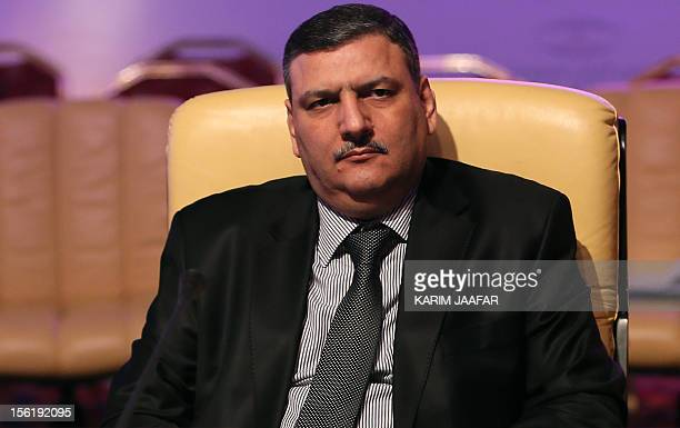 Former Syrian premier Riad Hijab who defected in August attends a meeting to form a new Syrian opposition group called the National Coalition of...