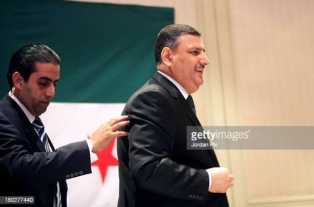 Former Syrian Prime Minister Riad Hijab holds a press conference August 14 2012 in Amman Jordan In his first public appearance since defecting Haijab...