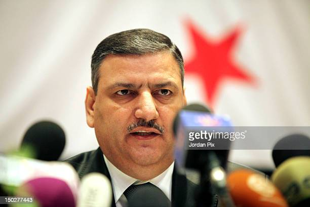 Former Syrian Prime Minister Riad Hijab speaks during a press conference August 14 2012 in Amman Jordan In his first public appearance since...