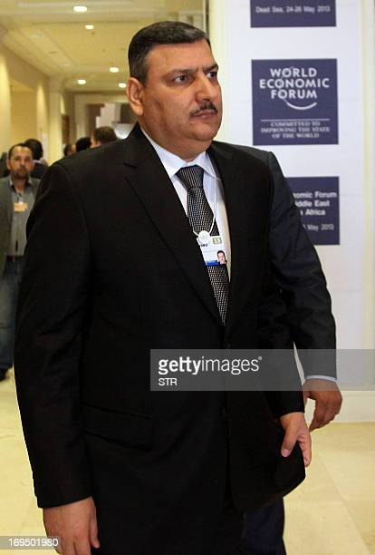 Former Syrian prime minister Riad Hijab who defected in August 2012 attends the final day of the World Economic Forum on the Middle East and North...