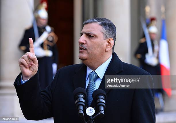 Former Syrian Prime Minister Riyad Farid Hijab delivers a speech to press after his meeting with President of France Francois Hollande in Paris...