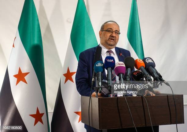Former Syrian Provisional Government Prime Minister Ahmet Tuma makes a speech on the achievements of Sochi agreement at the Syrian National Coalition...