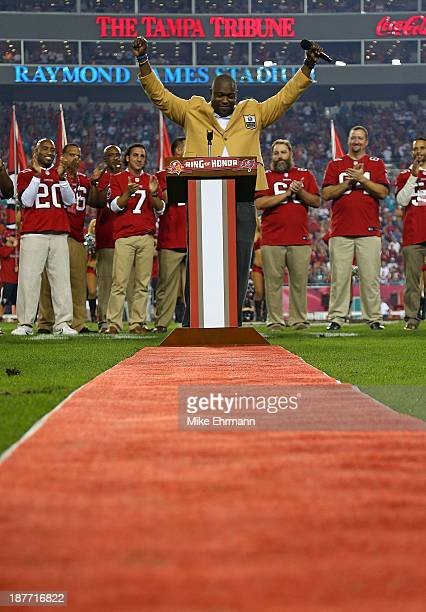 Former Tampa Bay Buccaneer Warren Sapp speaks at a ceremony retiring his number during a game against the Miami Dolphins at Raymond James Stadium on...