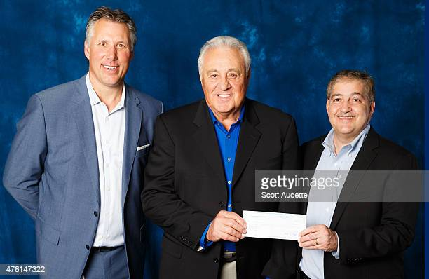 Former Tampa Bay Lightning Captain Dave Andreychuk and Owner of the Tampa Bay Lightning Jeff Vinik honor Phil Esposito as the 53rd Community Hero of...