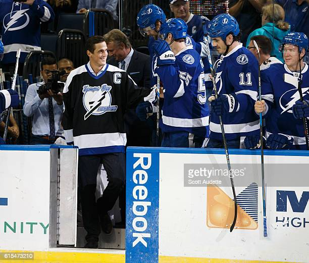 Former Tampa Bay Lightning player and captain Vincent Lecavalier is greeted by the current team as he is honored before the game against the Florida...