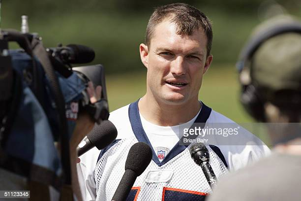Former Tampa Bay safety John Lynch of the Denver Broncos talks with reporters after the first full session of training camp at Dove Valley on July 28...