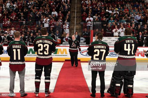Former team captain Keith Tkachuk of the Arizona Coyotes walks to center ice while waving to the crowd as Dallas Drake Oliver EkmanLarsson Teppo...