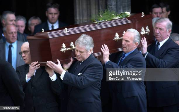Former team colleagues Willie Henderson Alex Willoughby Ralph Brand and John Greig carry the coffin at the funeral of Rangers football legend Jim...