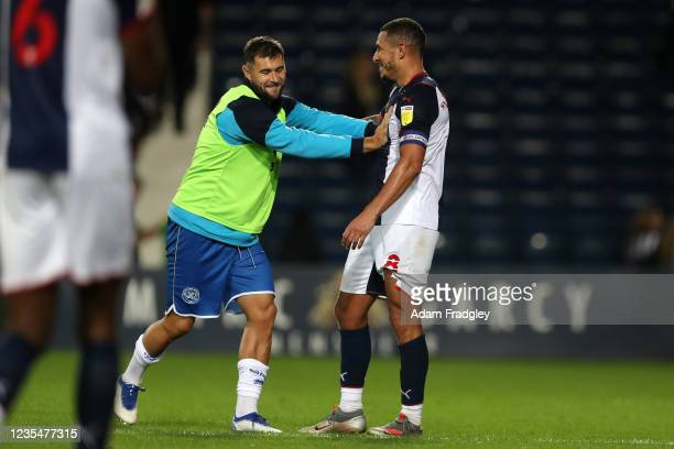 Former team mates Charlie Austin of Queens Park Rangers and Jake Livermore of West Bromwich Albion share a laugh at the end of the Sky Bet...