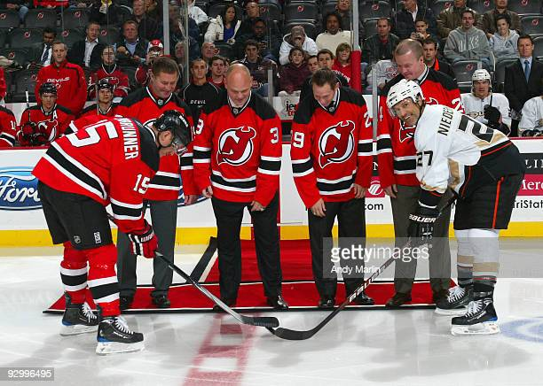 Former team members of the 2003 Stanley Cup Champions New Jersey Devils Bobby Carpenter Ken Daneyko Grant Marshall and Turner Stevenson drop the puck...