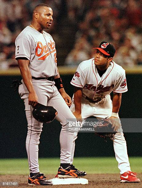 Former teammates Baltimore Orioles right fielder Albert Belle and Cleveland Indians second baseman Roberto Alomar visit at second base during a...