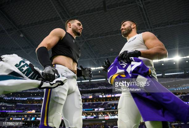 Former teammates Harrison Smith of the Minnesota Vikings and Andrew Sendejo of the Philadelphia Eagles exchange jerseys after the game at U.S. Bank...